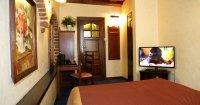 Single Business - un grand lit double continental, petit-déjeuner inclus dans le prix de la chambre, la deuxième personne dans la chambre + supplément de 50 PLN avec petit-déjeuner