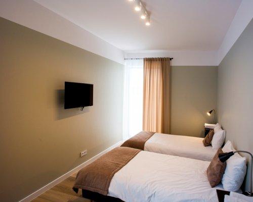 Domek - pokój TWIN ze wspólnym salonem i aneksem